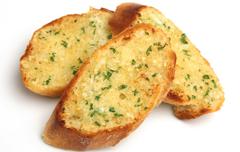 Foto Stokbrood met kruidenboter of knoflook